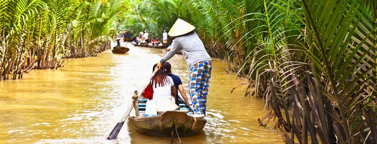 Mekong woman riding a boat